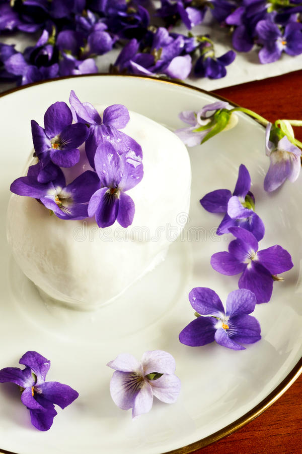 Ice cream with violets royalty free stock photography