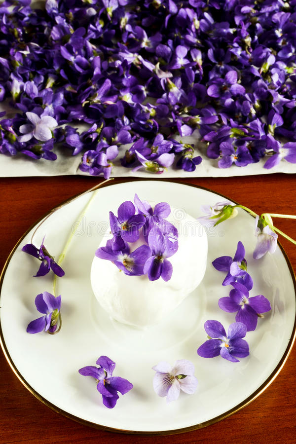 Ice cream with violets royalty free stock photos