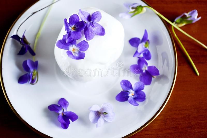 Ice cream with violets royalty free stock images