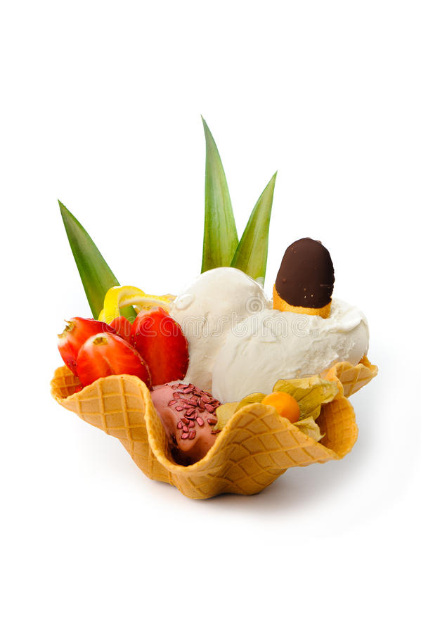 Ice cream on waffle. Ice cream served with fresh fruits on a waffle royalty free stock photography