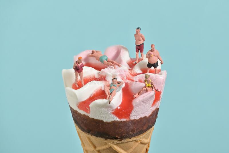 Ice Cream In Waffle Cone and Miniature People royalty free stock image