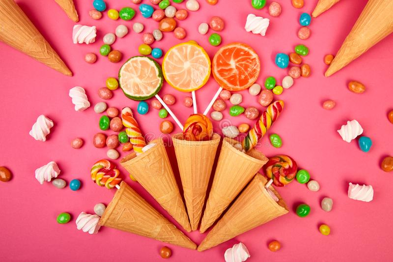 Ice cream waffles cones with colorful candy royalty free stock image