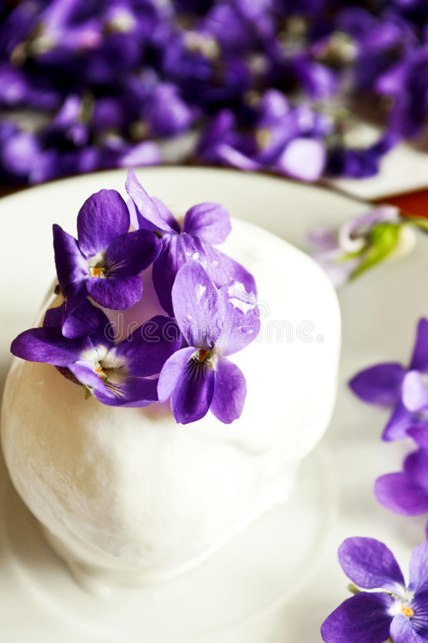 Ice cream with wild violets stock photography