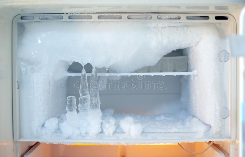 Ice crystals icebox freezer in refrigerator. Old kitchen ware technology, appliance, cool, electric, backdrop, icy, temperature, clean, shelf, frosty, open royalty free stock photos