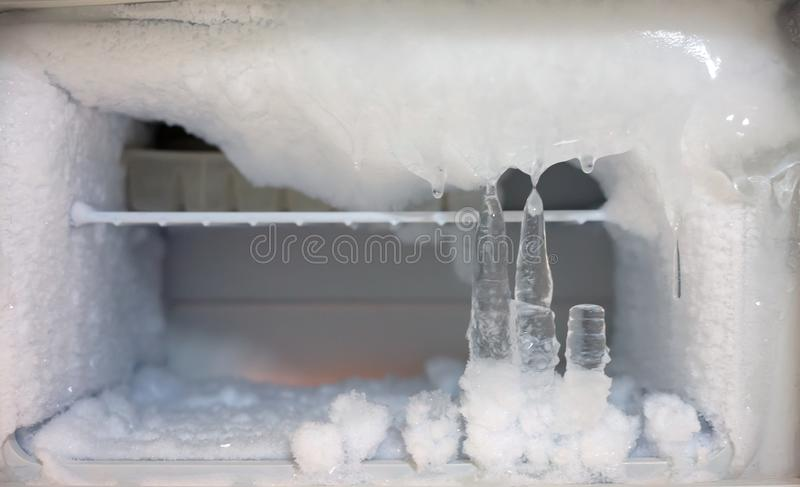 Ice crystals icebox freezer in refrigerator. Old kitchen ware technology, appliance, cool, electric, backdrop, icy, temperature, clean, shelf, frosty, open stock photography