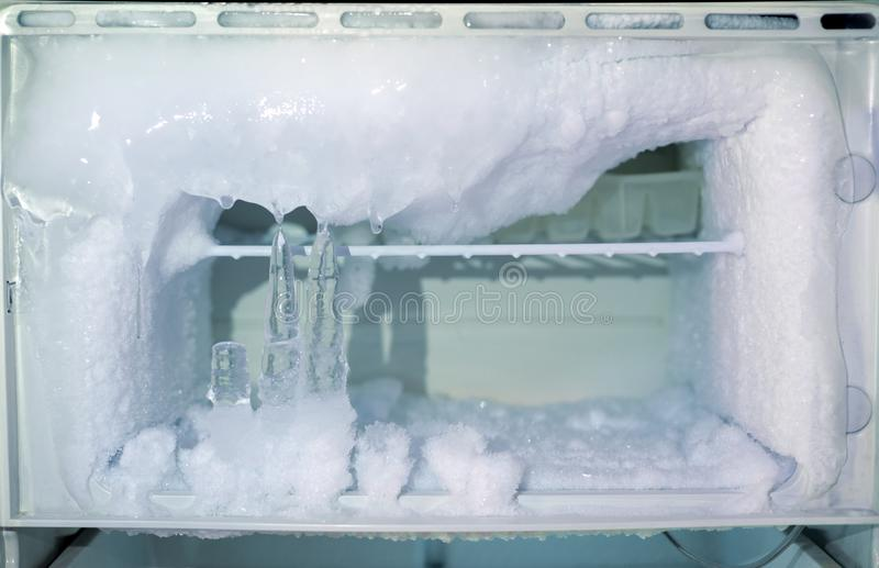 Ice crystals icebox freezer in refrigerator. Old kitchen ware technology, appliance, cool, electric, backdrop, icy, temperature, clean, shelf, frosty, open stock photos