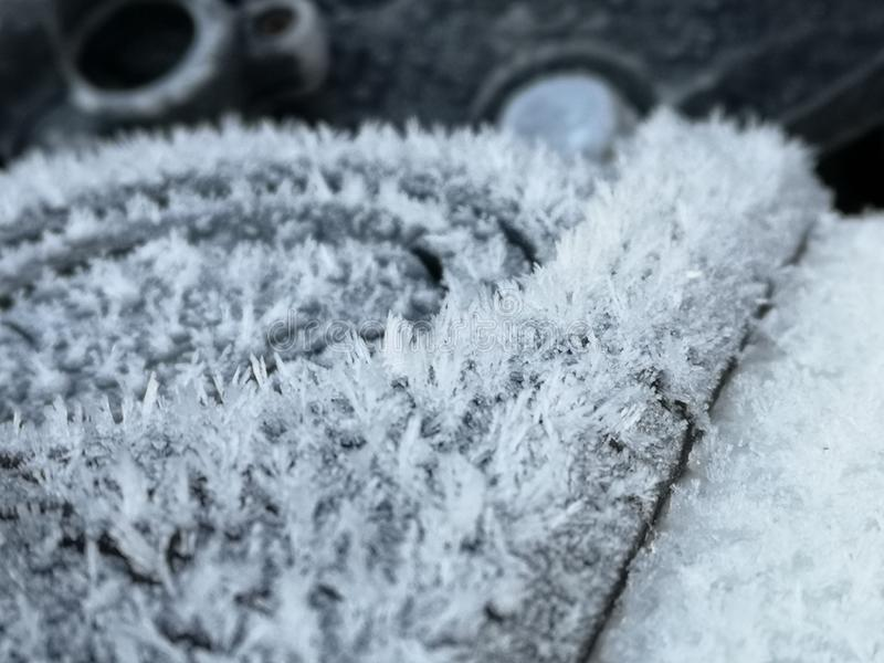 Ice crystals on a motorbikes petrol tank. Oznor ice crystals motorbikes petrol tank snow freezing winter cold minus celsius royalty free stock photography
