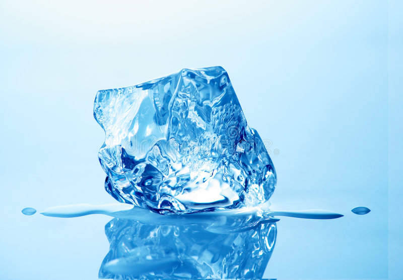 Ice cube. Melting ice cube with blue toning in background royalty free stock photos