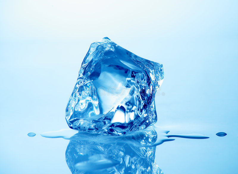 Ice cube. Melting ice cube with blue toning in background stock photo