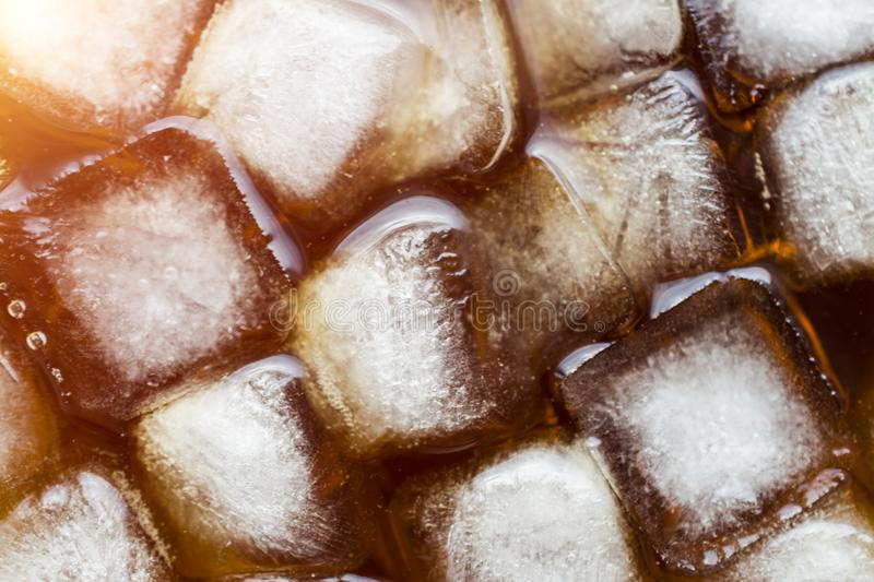 Ice cube with cola royalty free stock photography