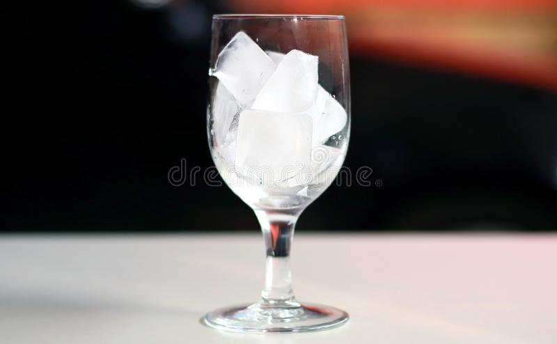 Ice Cube in glass. Ice cube in a glass stock photo