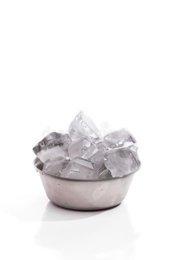 An ice cube in the steel bowl over white background stock image