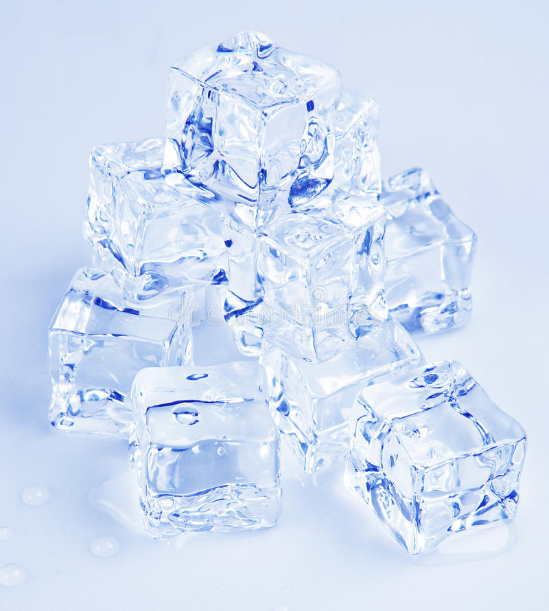 Ice cubes. Details of a pile of ice cubes. Blue tone modified royalty free stock photography