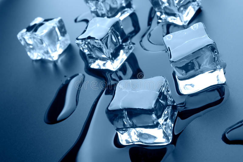 Ice cubes. Thawing cubes of ice close up stock photography