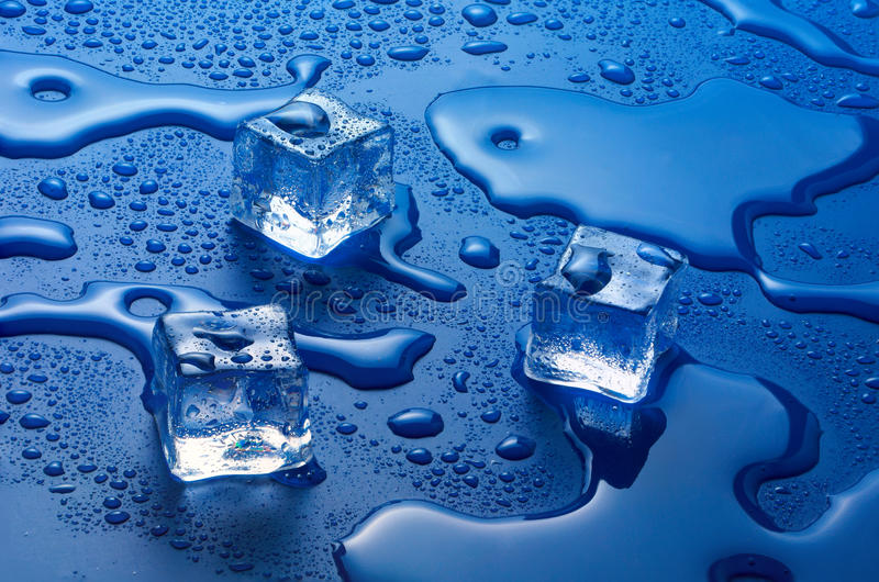 Ice cubes. Melting ice cubes on a mirrored background stock photo