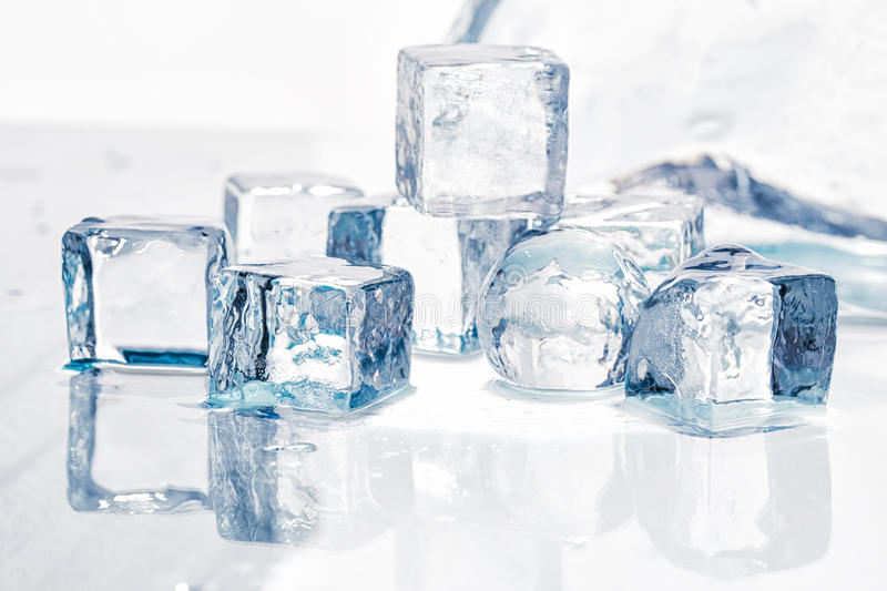 Ice cubes and balls. On a wet table studio shot royalty free stock image