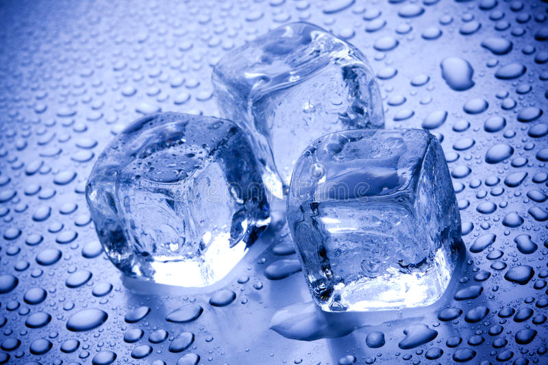Ice Cubes Closeup. On blue background with bubbles stock images