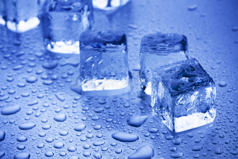 Ice Cubes Closeup. Ice CUbes placed on blue light. Frozen concept royalty free stock photos