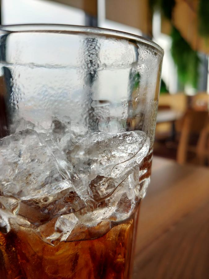 Ice cubes in a glass of beverage. stock images
