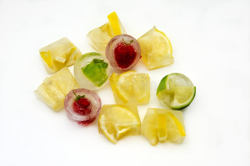 Ice cubes with lemons and strawberries royalty free stock photo