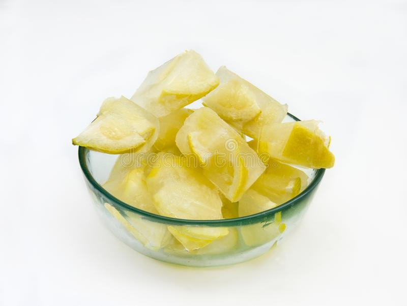Ice cubes with lemons stock photo
