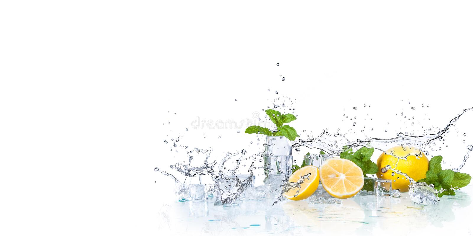 Ice cubes, mint leaves with lemons royalty free stock images