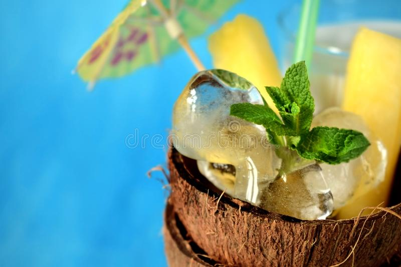 Ingredients for a tropical cocktail on blue background royalty free stock photos