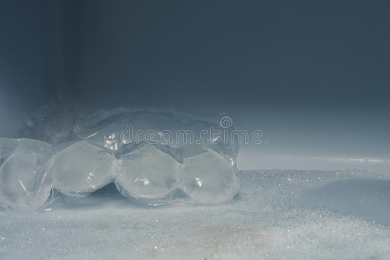 Ice cubes in the package. In the freezer stock images