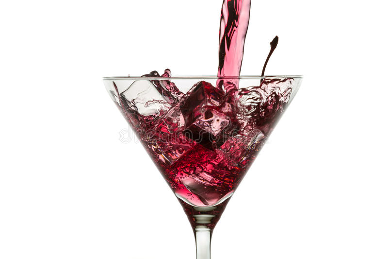 Ice cubes and red liqueur in a glass of martini royalty free stock photo