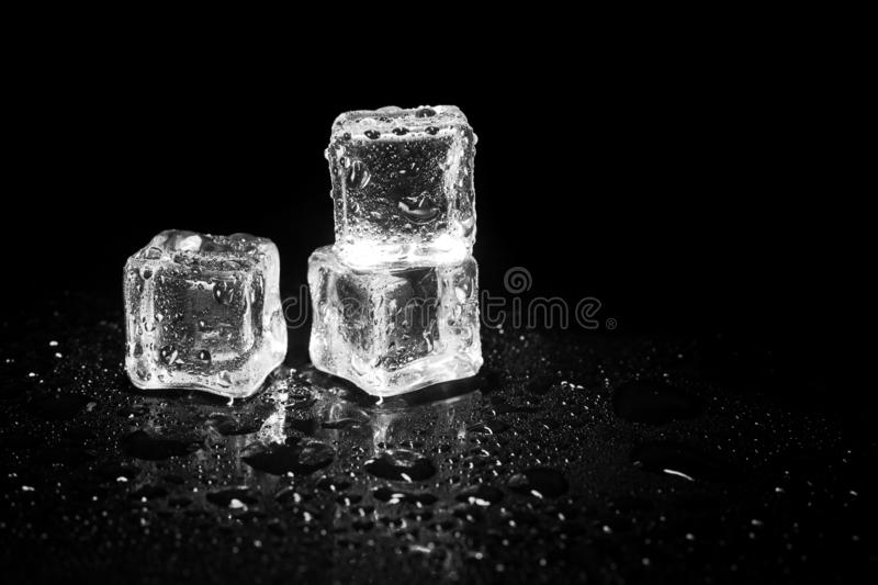 Ice cubes reflection on black table background. Abstract, bar, beautiful, block, blocks, bright, clean, clear, closeup, cold, cool, cracked, crushed, crystal stock photos