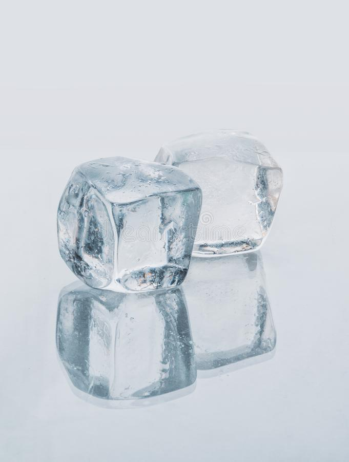 Ice cubes with reflection, isolated. Isolated stock images