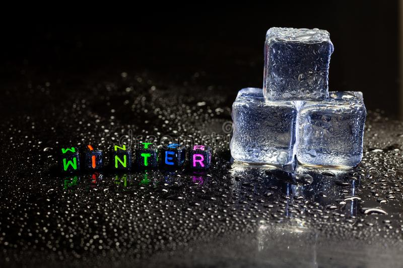 Ice cubes reflection and Winter on black table background. Abstract, bar, block, blue, brick, bubble, chilled, clear, closeup, cold, cool, crushed, crystal royalty free stock photo