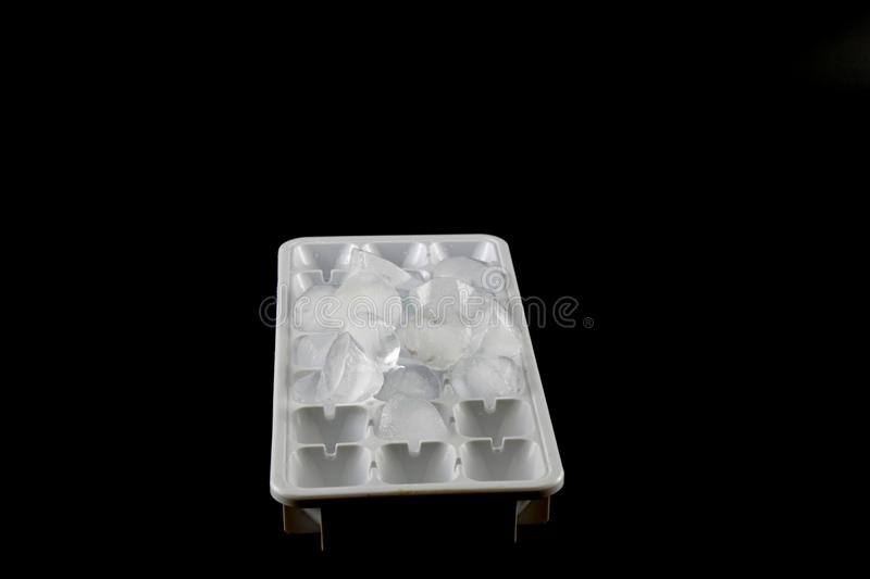 Ice cubes removed from the ice cube. Black Background, cold, refrigerator, white, fridge, water, fresh, tray, mold, freezer, clean, frost, isolated, design stock photography