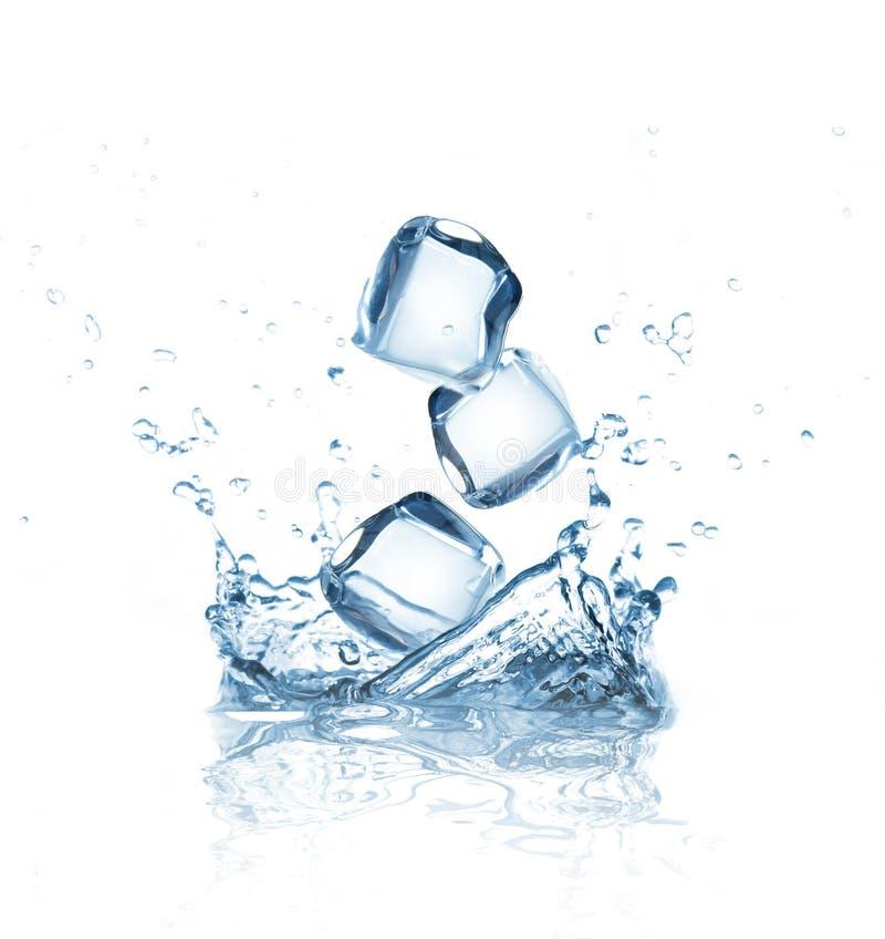 Ice cubes splashing into the water stock photos