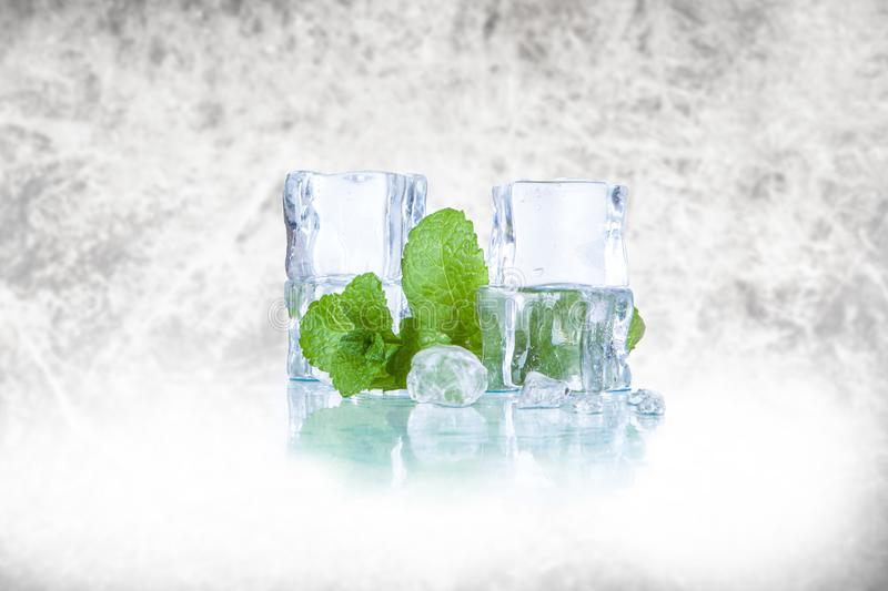 Ice cubes and mint leaves stock photo