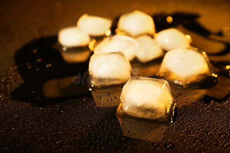 Ice cubes on surface with drops royalty free stock image