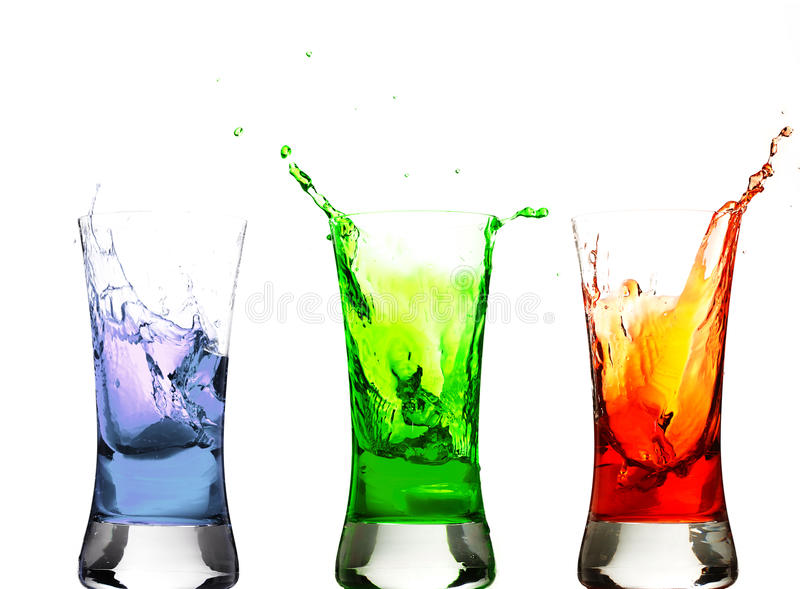 Ice cubes thrown in some glasses stock images