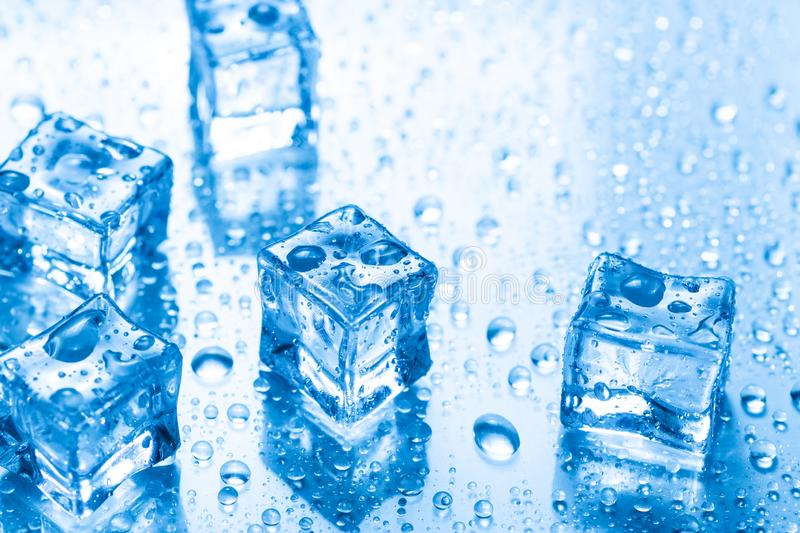 Ice cubes with water drops royalty free stock photography