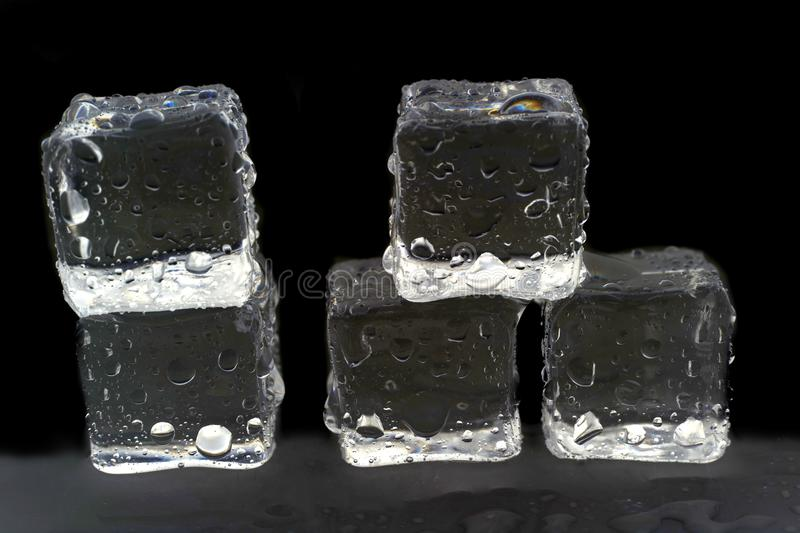 Ice cubes on white background. Ice cubes reflection on black table background, bar, block, brick, bubble, closeup, cold, cool, crystal, drink, drop, food royalty free stock photo