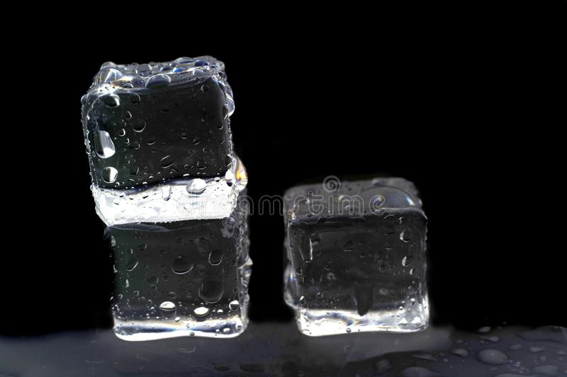 Ice cubes on white background. Ice cubes reflection on black table background, bar, block, brick, bubble, closeup, cold, cool, crystal, drink, drop, food royalty free stock images