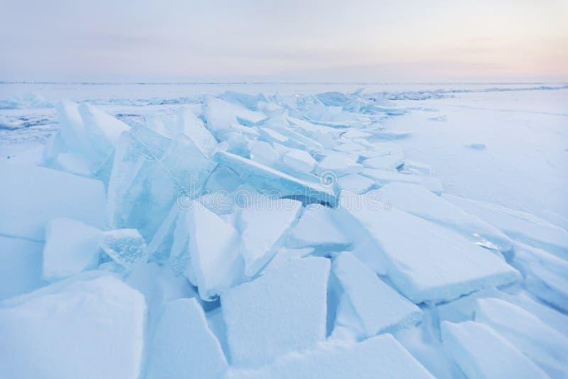 Ice-drift of Baikal lake. Turquoise ice floe. Winter landscape. Turquoise ice floe. Winter sunset landscape. Ice-drift of Baikal lake royalty free stock photography