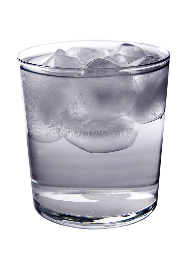 Ice filled Water. A glass full of ice and water isolated on white stock photography