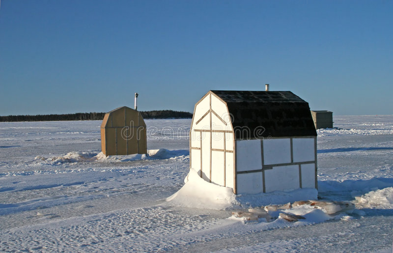 Ice Fishing Shacks royalty free stock photography
