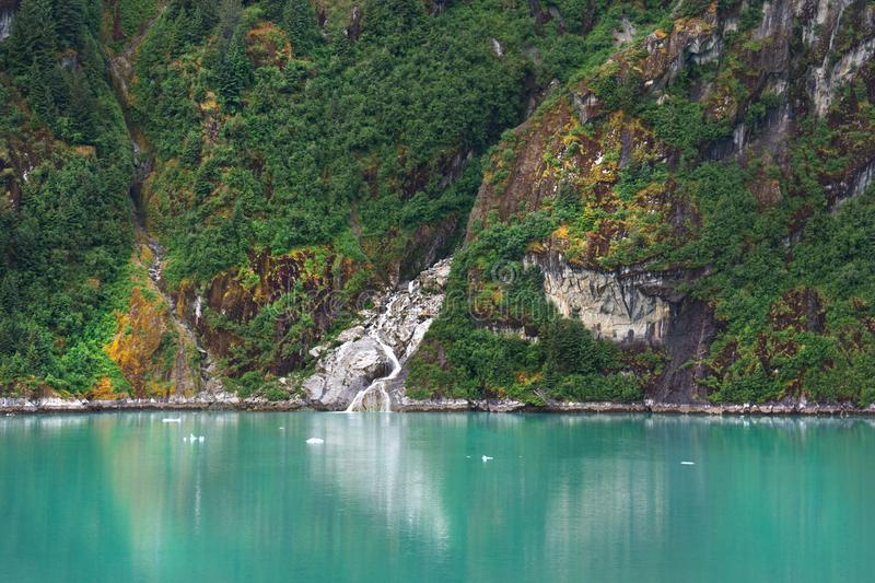 Alaska Inside Passage Cliffs and waterfall stock photography