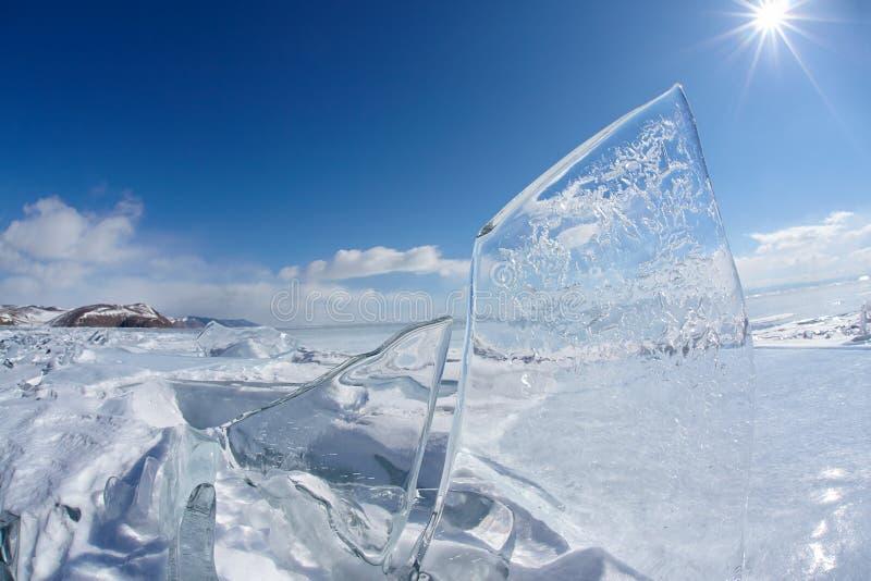 Ice floe and sun on winter Baikal lake. Ice floe and sun over winter Baikal lake stock image