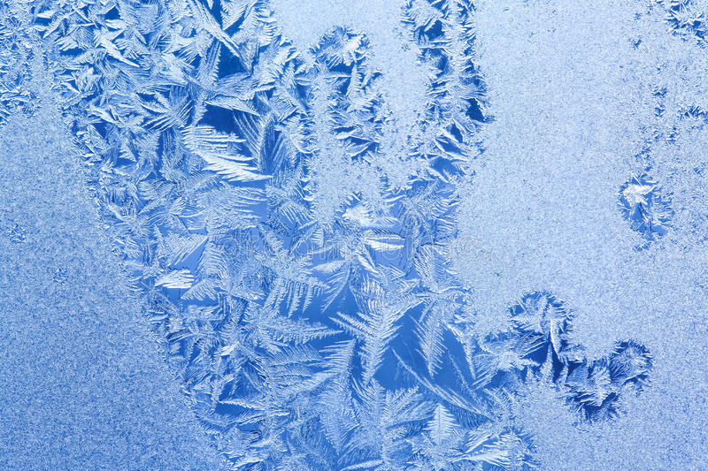 Ice flowers and frozen window background. Macro view photography frost textured pattern. cold weather concept. shallow. Depth of field photo royalty free stock photos