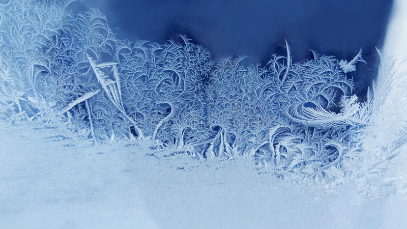Ice flowers frozen window background. macro view photography frost textured pattern. cold winter weather xmas concept royalty free stock photography