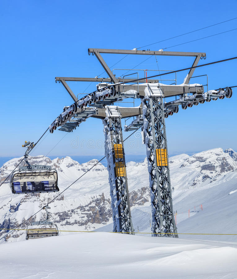 Ice Flyer ski lift on Mt. Titlis in Switzerland. Mt. Titlis, Switzerland - 9 March, 2016: the Ice Flyer ski lift, view from the station on the top of the royalty free stock images