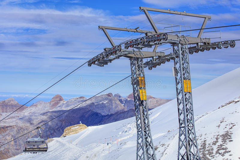 Ice Flyer ski lift. Mt. Titlis, Switzerland - 12 October, 2015: the Ice Flyer ski lift, view from the station on the top of the mountain. Titlis is a mountain of royalty free stock photo