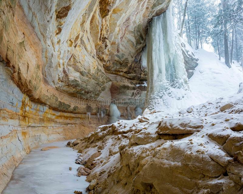 Ice formation, Munising, Michigan, pictured rocks national lakeshore. Ice formation and sandstone cliff on the North Country Trail near Sand Point in the stock photos